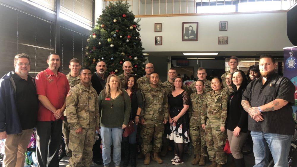 Military personnel, Seafarers and Santa's Castle representatives are pictured at the Tacoma hall