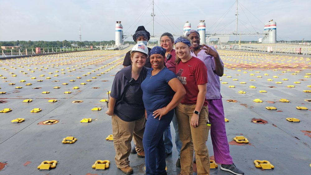 Group photo of mariners aboard ship